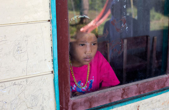 Mentawai girl trapped in a school classroom