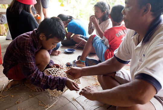YPBM student learning to weave Mentawai basket