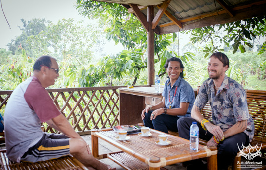 Suku Mentawai Director, Esmat Sakulok, and Rob Henry discussing the cultural education program with Mentawai Bupati, Yudas Sabaggalet