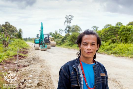 Suku Mentawai Director, Esmat Sakulok, filming on the Trans Mentawai, Siberut salatan.