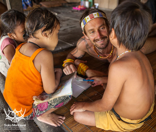 IEF Director, Rob Henry, working on a cultural education booklet with Mentawai children