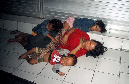 Mother and her children sleeping on the streets in Bali, Indonesia