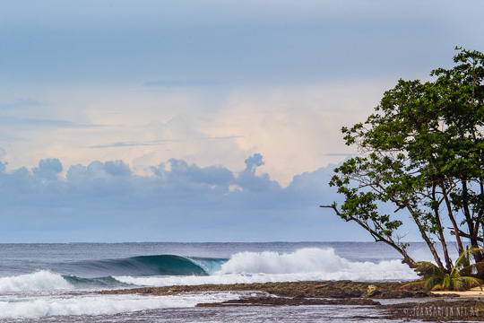 Idyllic looking waves and tropical island destination in Mentawai, by John Barton