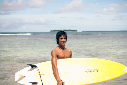 Young Mentawai surfer looking stoked